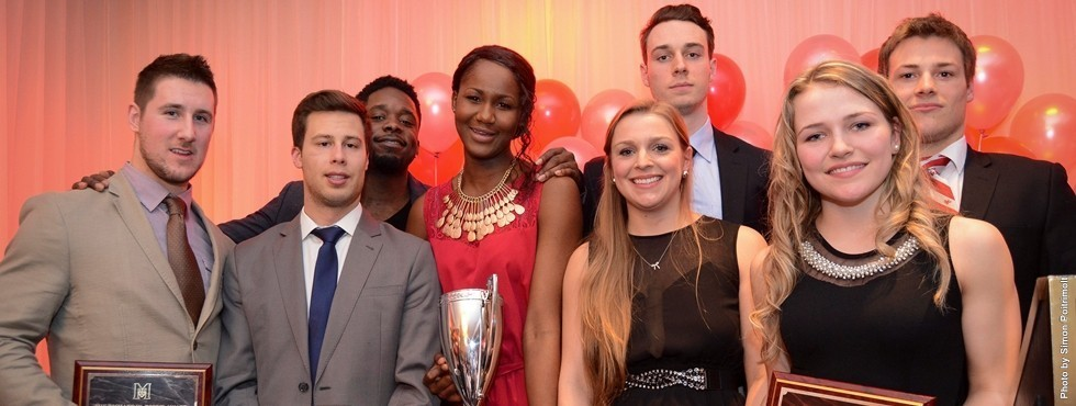 McGill's major trophy recipients (L to R): Benoit Levesque (Pound Trophy), Cedric McNicoll (Forbes Trophy), Jonathan Telfort (Teskey Award), Mariam Sylla (Bean Trophy), Valerie De Broux (Roscoe Trophy), Francois Bourque (Auders Award), Marika Guerin (top female rookie) and Karl Forgues (top male rookie)